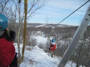 Ziplining down the longest (1,500 foot) cable. Copyright Deborah Abrams Kaplan
