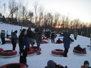 We join the lines waiting to go down the hill. Nice sunset in the background, right? Copyright Deborah Abrams Kaplan