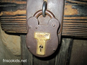 This is one of my favorites. It's on Pirate Lair island inside one of the caves. You'll also find one of these locks outside the Pirates of the Carribbean ride, on the store door as you exit.