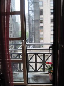 The room balcony at Hotel Giraffe. Copyright Deborah Abrams Kaplan