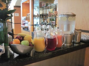 Juices and fruits were part of the complementary breakfast  at Hotel Giraffe. Copyright Deborah Abrams Kaplan