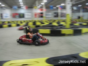 One of the racers rounds the curve at Pole Position Raceway in Jersey City. Copyright Deborah Abrams Kaplan