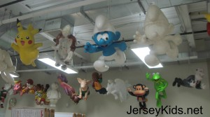 Models of balloons from the Macy's Thanksgiving Day Parades past and present, at Macy's Studio.