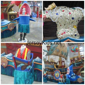 People will stand inside these costumes, including the pirate inside the shark.