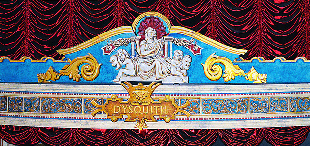 The D'Ysquith insignia on top of the stage on the stage