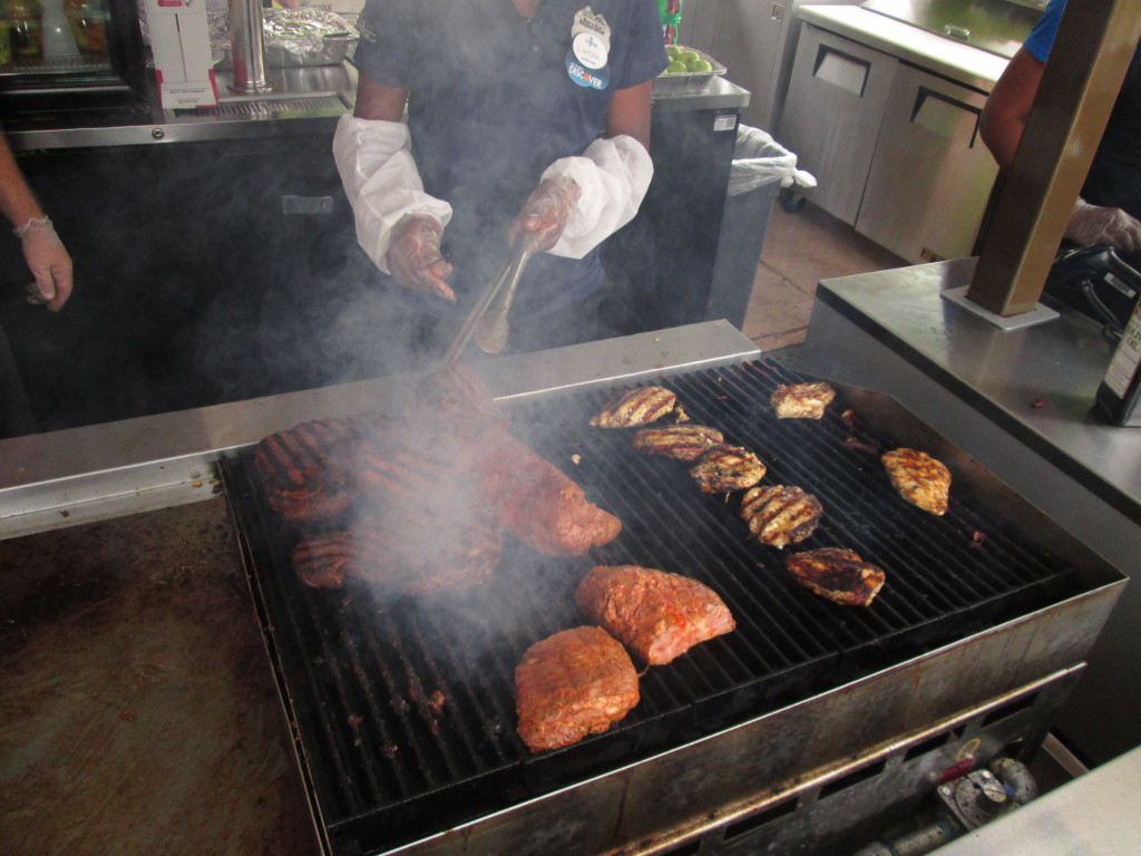 Cooking up the meat at the Cabana Cove Bar and Grill. Photo by Deborah Abrams Kaplan