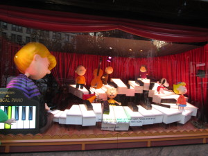 You can help play Linus's piano in this Macy's Peanuts window display. It's not a full set of keys, though, and the sound leaves something to be desired! Copyright Deborah Abrams Kaplan