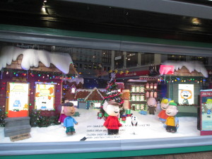 This Macy's Peanuts window display is supposed to let you change Charlie Brown's outfit that he wears in the house, but it wasn't working. Copyright Deborah Abrams Kaplan