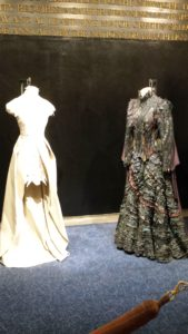 The original Elphaba costume (right) and the reimagined Glinda costume (by a Project Runway designer) on left.