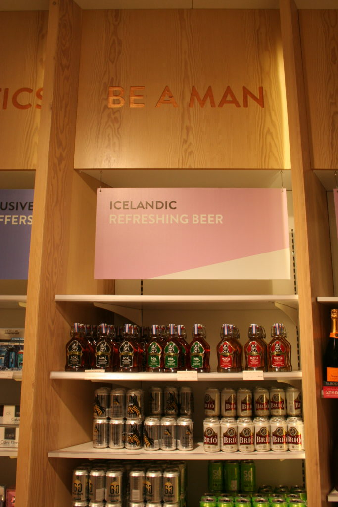 Be a man! Drink beer. Duty free store at Keflavik airport. Copyright Deborah Abrams Kaplan