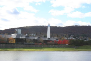 Corning's well-known tower with a picture of a gaffer on top. In the foreground is the corporate office for Corning Glass.
